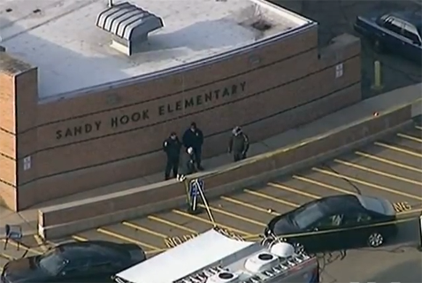 Police arrive at Sandy Hook Elementary, after the shooting on December 14, 2012.